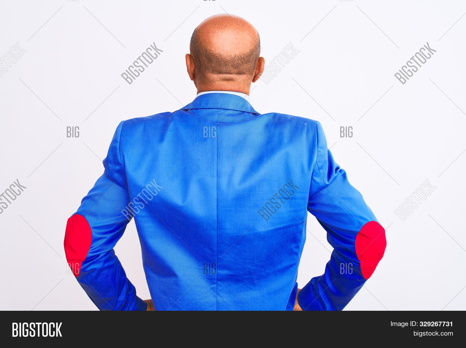 Middle age businessman wearing suit standing over isolated white background standing backwards looki