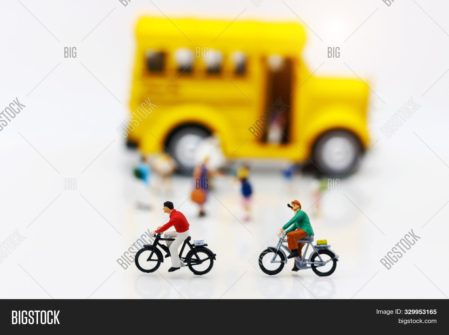 Miniature People Enjoy Riding A Bicycle With School Bus.