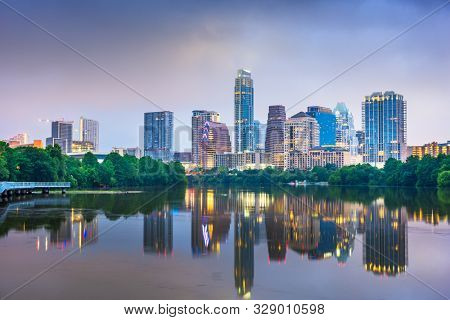 Austin, Texas, USA downtown skyline on the Colorado River at night. stock photo