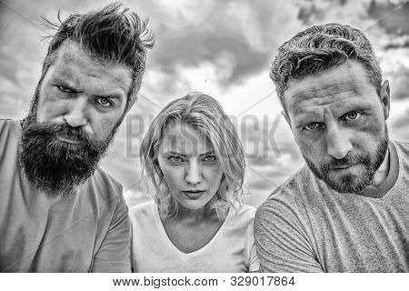 Group people suspect you. Suspicious look. Threesome suspiciously look down. Woman and men look confident sky background. Strength in unity. Stand up for their position. They know what you did stock photo