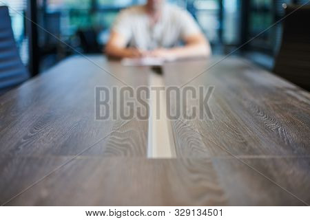 Employee in office conference room. Manager at table in modern meeting room for business negotiations and business meetings. Interview with a new employee. stock photo