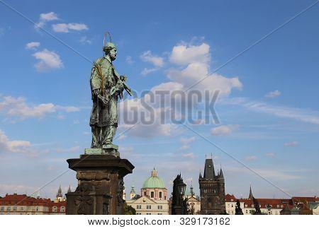 statue of John Nepomucene at Charles Bridge in Prague Czech Republic stock photo