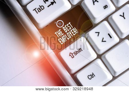 Text sign showing The Best Employer. Conceptual photo created workplace showing feel heard and empowered White pc keyboard with empty note paper above white background key copy space. stock photo