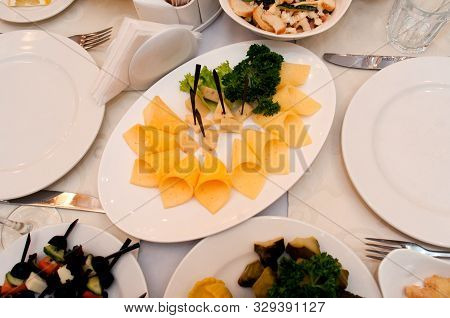 Pieces of hard cheese on a plate. Festive delicious a food for Easter. stock photo