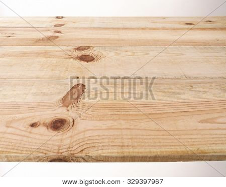Solid pine wood sheets with dark colored knots.- Close-up of light beige solid pine wood sheets with dark knots, forming a board. stock photo
