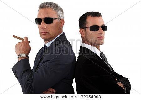 Powerful businessmen in sunglasses stock photo
