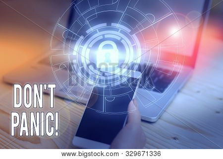 Text sign showing Don T Panic. Conceptual photo suddenly feel so worried or frightened that you can not behave Picture photo system network scheme modern technology smart device. stock photo