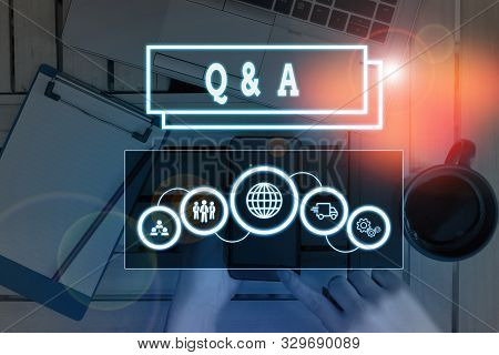 Conceptual hand writing showing Q And A Question. Business photo showcasing in which demonstrating asks questions and another one answers them Picture photo network scheme with modern smart device. stock photo