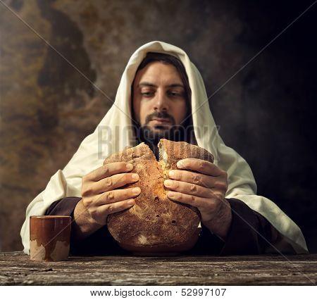 The Last Supper Jesus breaks the bread. stock photo