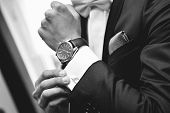 Man with suit and watch available