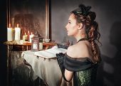 Beautiful Woman In Medieval Dress Near Mirror