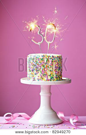 30th birthday cake with sparklers stock photo