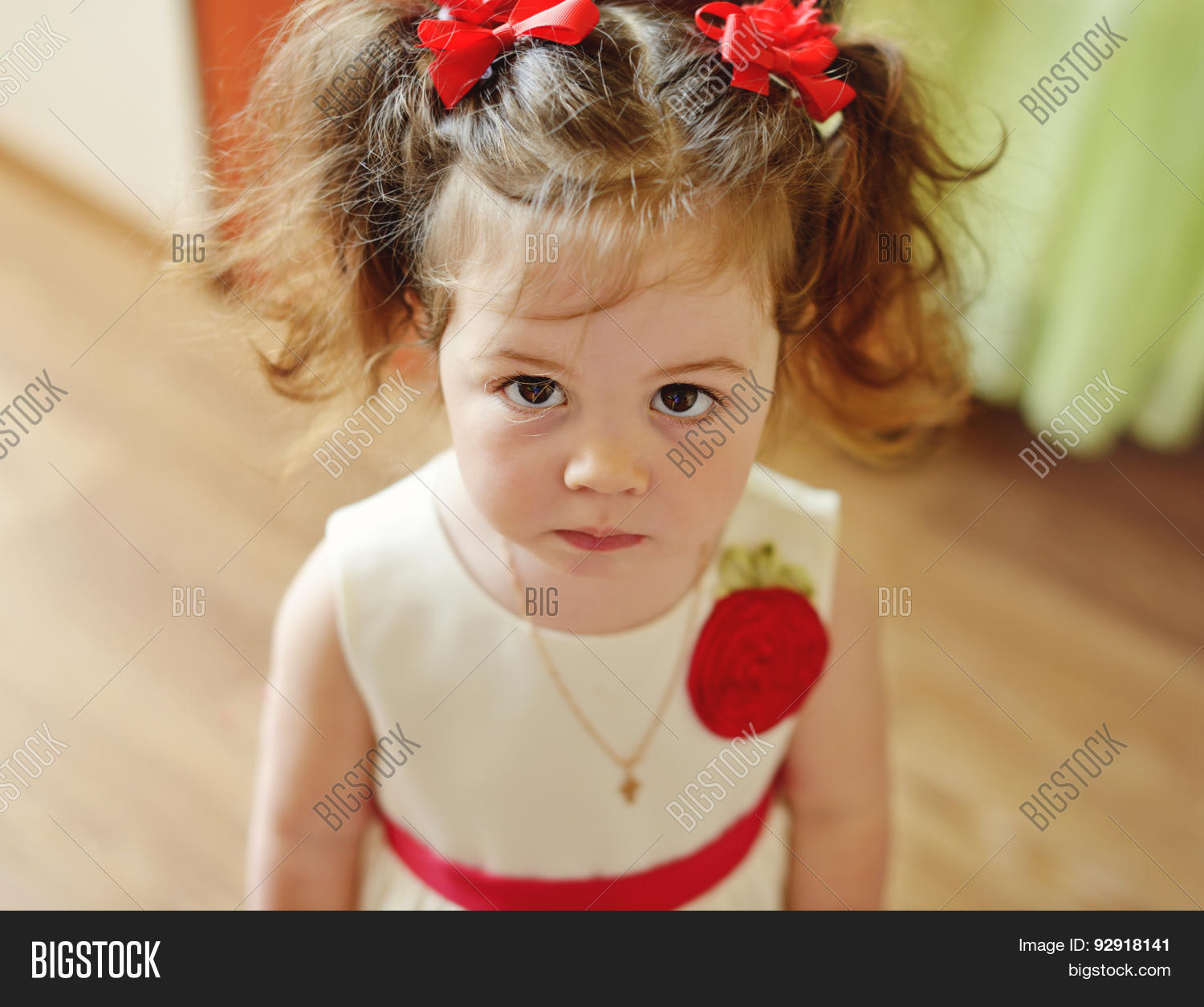 2,amazed,angel,astonishment,baby,background,big,brown,brunette,cheek,cheerful,child,childhood,curly,cute,daughter,dress,enjoying,eye,face,fashion,fun,funny,girl,glad,hair,happiness,happy,hazel,healthy,indoors,innocence,joyful,kid,little,long,looking,merry,pleased,pony,portrait,serious,smile,surprised,sweet,tail,tenderness,toddler,well-dressed,years