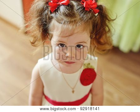 serious toddler girl looking in the camera stock photo