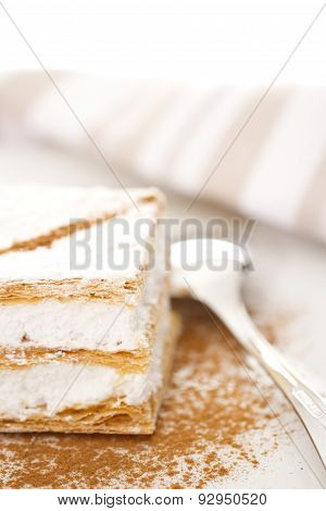 puff pastry filled of meringue with cinnamon stock photo