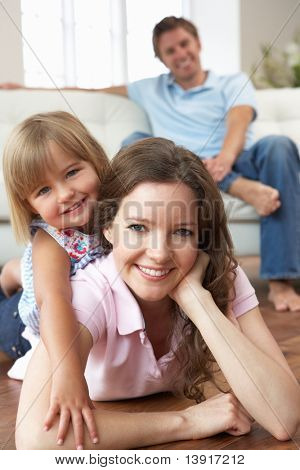 Portrait Of Happy Family Relaxing At Home stock photo