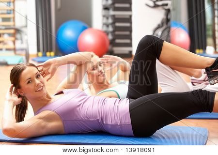 Women Doing Stretching Exercises In Gym stock photo