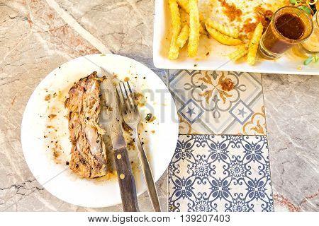 Dirty and empty steak dish with rib bone stock photo