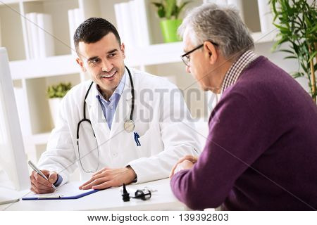 Doctor Explaining Prescription To Senior Patient