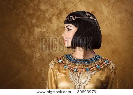 Fashion Stylish Beauty Portrait with Black Short Haircut and Professional Make-Up of Cleopatra. Beautiful Girl's Face Close-up. stock photo