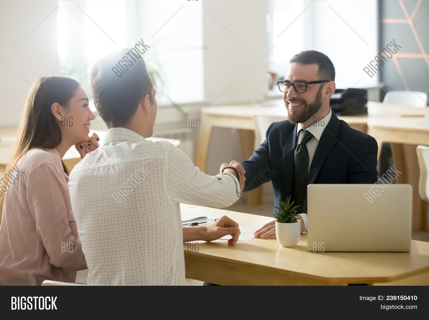 Smiling Lawyer, Realtor Or Financial Advisor Handshaking Young Couple Thanking For Advice, Insurance