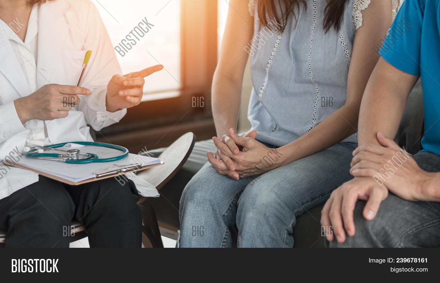 Patient Couple Having Doctor Or Psychologist Consulting On Marriage Counseling, Family Medical Healt