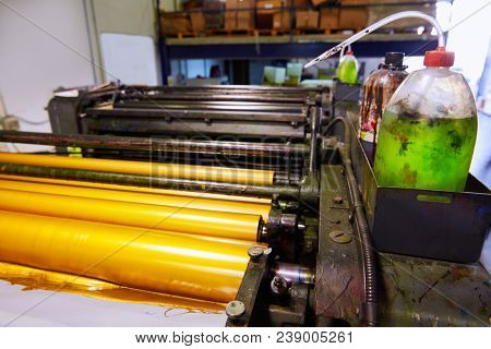 Printer ink machine rotary printing factory golden printer rollers stock photo