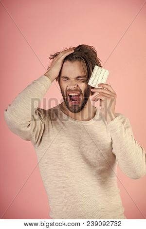 Drug and antidepressant, insomnia. Dieting pill and vitamin, man with anabolic. Health and medicine, hangover. Cold, flu and headache treatment, hypnotic tablet. Man with pills in blister pack. stock photo