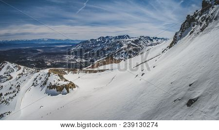 Panoramic view of snow-covered Sierra Nevada Mountain Range from the summit of Mammoth Mountain, Mammoth Lakes, California stock photo