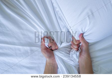 Great concept of bed messy, unkempt, white bed, crumpled sheet. stock photo