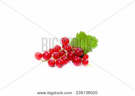 Close up view of several red sweet cherries and big green leaf of cherry tree on the marble table and ripe sweet cherries in yellow wooden basket on background. Composition in rustic style - organic red sweet cherries in vintage wooden basket on dark marb stock photo
