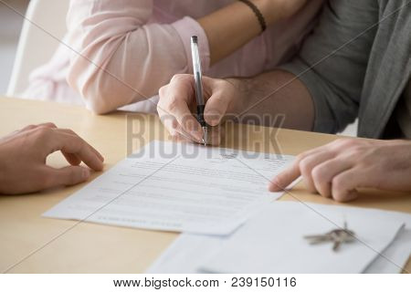 Couple Renters Tenants Signing Rental Agreement Renting New House, Customers Buyers Put Signature On