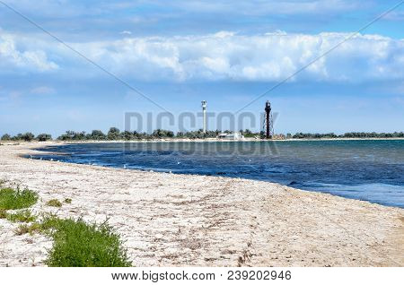 Sea waves washed clean beach made of shells. Landscape on a wild beach. stock photo