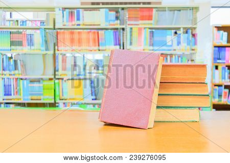 old book red - green. heap are interior library school on wooden table and blurry bookshelves background. education learning concept with copy space add text stock photo
