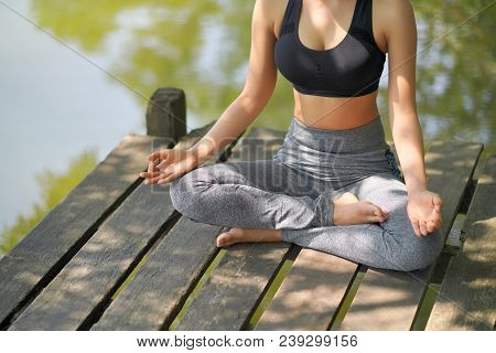 Woman do yoga outdoor. Woman exercising vital and meditation for fitness lifestyle club at the nature background. Healthy and Yoga Concept stock photo