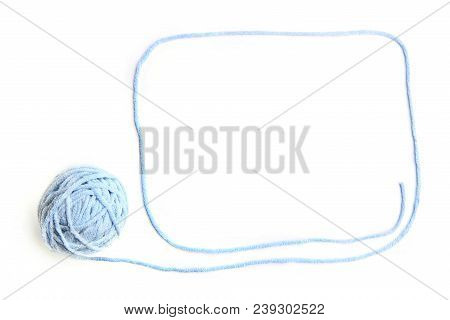 Blue thread ball with frame made of thread isolated on white background. Cotton thread ball with empty frame. stock photo
