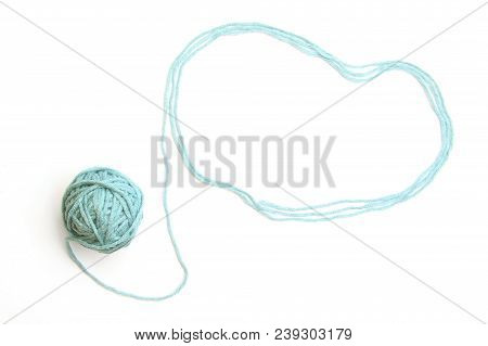 Cloud made of blue thread and thread ball  isolated on white background. Cotton thread ball with empty frame like cloud. stock photo