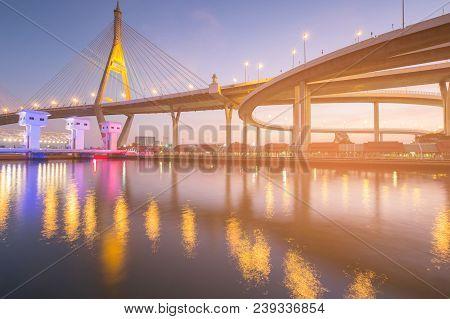 Night light reflection Rama suspension bridge over white watergate, Bangkok Thailand landmark stock photo