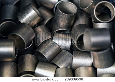 Glossy metal bushes or rings. Abstract industrial background stock photo