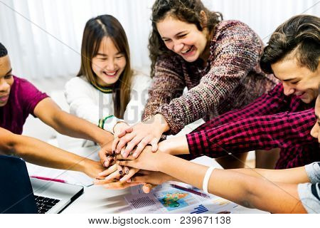 Classmates joining hands teamwork and success concept stock photo