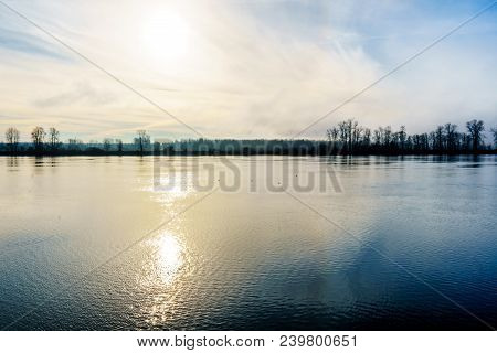 Fog over the Fraser River viewed from the Trans Canada Trail near the Bonson Community in Pitt Meadows, British Columbia, Canada stock photo