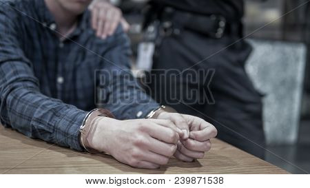 Criminal Arrested And Handcuffed While Police Grab Shoulder. Going To Jail.