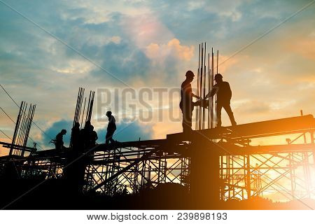Silhouette Of Engineer And Construction Team Working At Site Over Blurred Background Sunset Pastel F