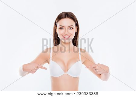 Portrait of beautiful perfect sexual slim lovely cute cheerful girl with good proportions demonstrating her sexy big tits isolated on white background, wellbeing, wellness concept stock photo
