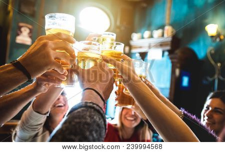 Group Of Happy Friends Drinking And Toasting Beer At Brewery Bar Restaurant - Friendship Concept Wit