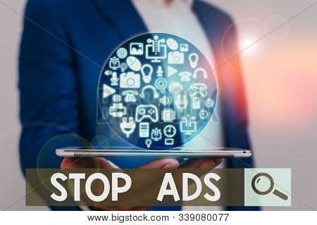 Word writing text Stop Ads. Business concept for program that will remove different kinds of advertising from Web. stock photo