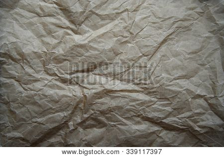 Abstract crumpled baking paper background. Top view of old brown beige Paper textures backgrounds for design, invitation, decorative paper texture concept. stock photo