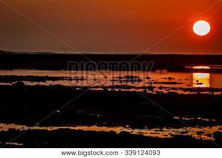 Sunset on the beach of the Corrales, fish pens, of Rota, Cadiz, Spain stock photo