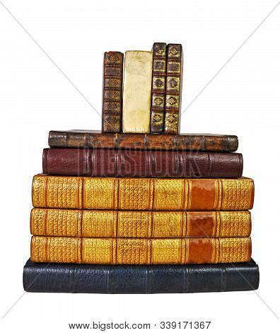 Isolated White Background, Shinny Antique Book Collection Shelf View, Stack of Antique Books. stock photo