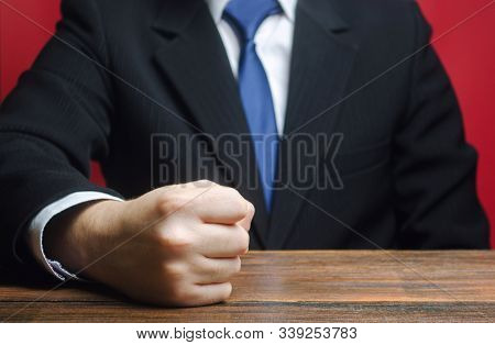 A businessman punched the table. End of patience. Impossible to bear it. An attack of anger, stress. A decisive, emotional gesture. That's enough! Choleric. Strictness and sociability, impulsiveness stock photo